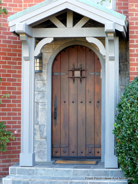 beautiful oval wooden front door with stone trim