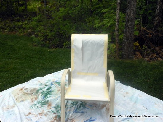 put the chair out in the open on a protective sheet or large piece of plastic to protect the area in which you are painting