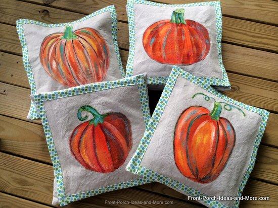 four pumpkin pillow toppers