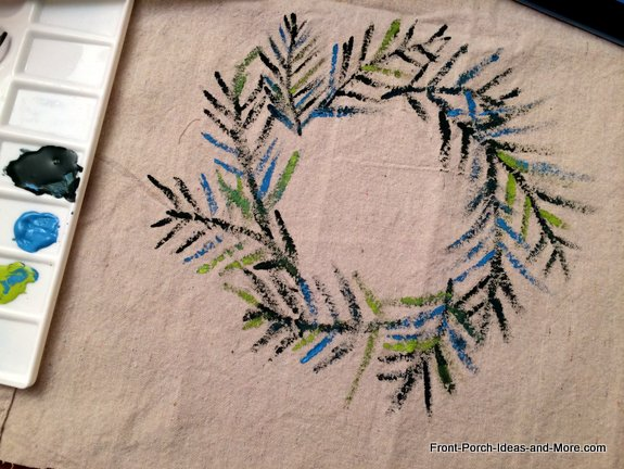 Paint a wreath on painters cloth using shades of green and blue