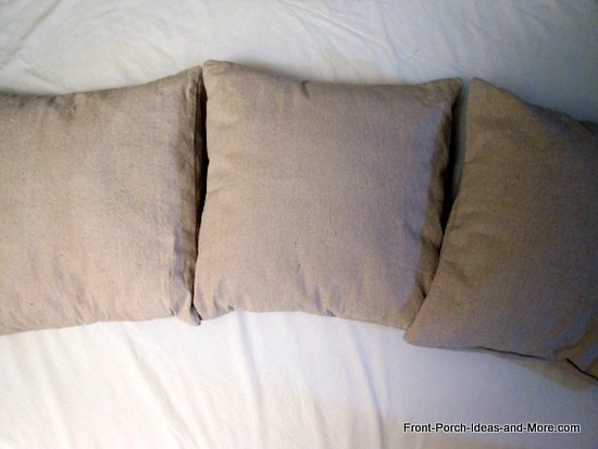 3 plain pillows made from painter drop cloth