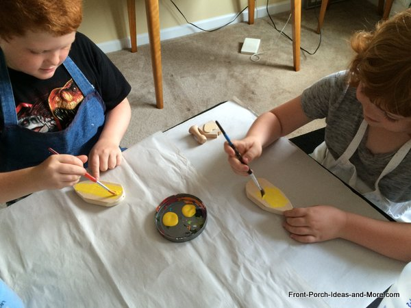 kids painting bumble bee for bumble bee decorations