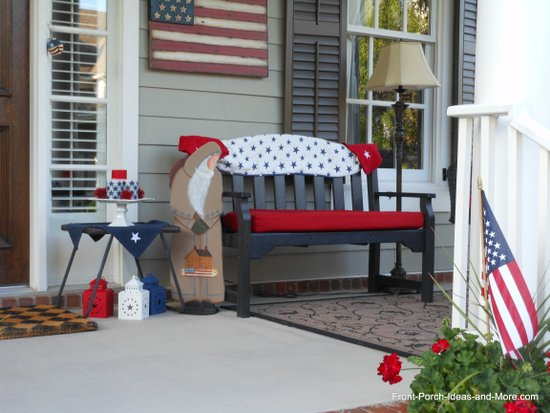 porch bench decorated for the 4th of July