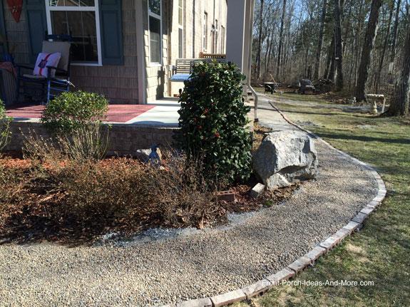 shoveling crushed stone for walkway