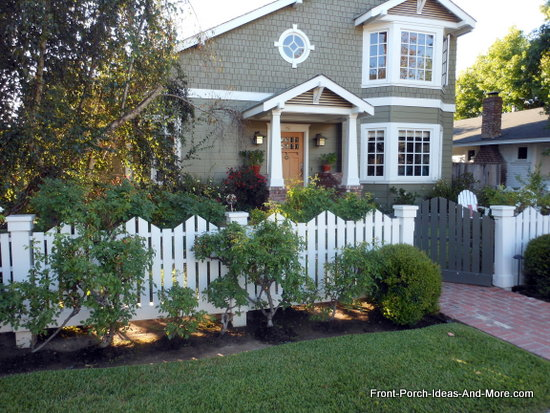 picket fence and landscaping add extra appeal to this porch
