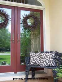 Rhonda's porch with black wrought iron bench
