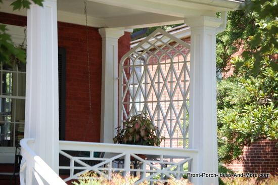 very lovely lattice privacy screen on end of front porch