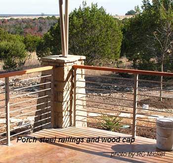 steel railings and wood cap