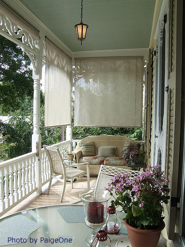 nicely decorated and furnished porch outdoor with mosquito curtains