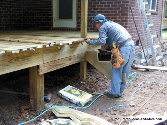aligning a stringer for steps from deck