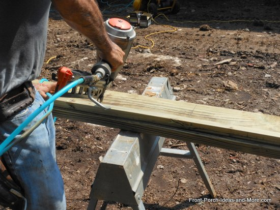 attaching a ledger strip to support the joists