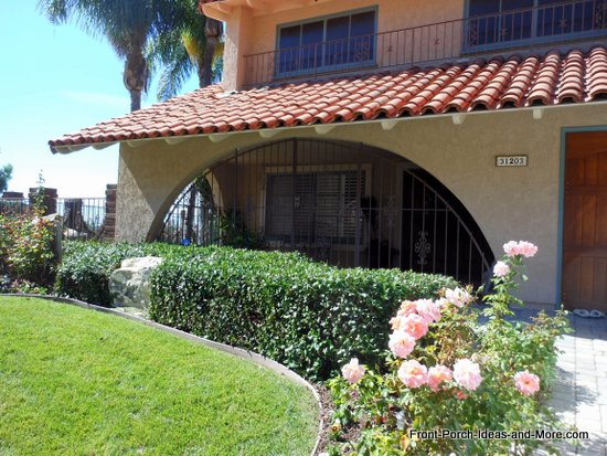 Rancho Palos Verdes front porch with tiled roof and romanesque style columns