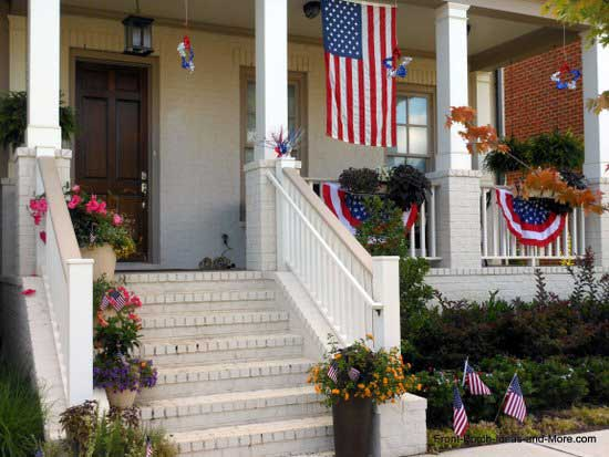 front porch decorated in red, white, and blue for the 4th of july