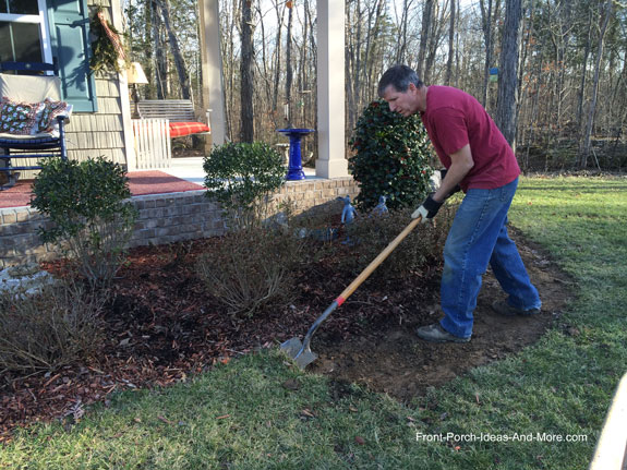 man with shovel removing sod for walkway