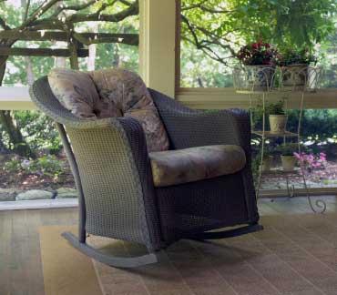 wicker rocking chair with lush cushion