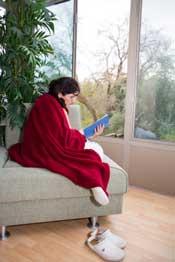 Woman reading book on 3 season porch
