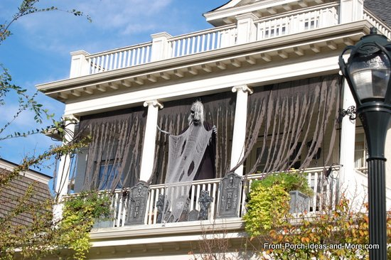 scary halloween decorations - lightweight monsters hanging from porch ceiling