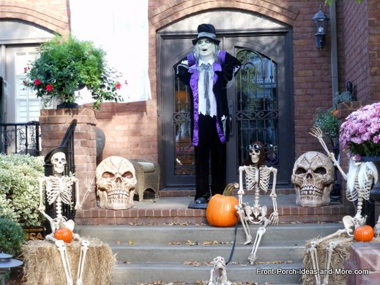 scary halloween decorations - closer view of the skeletons and dracula-like figures