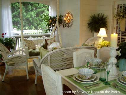 beautifully decorated and furnished screened porch
