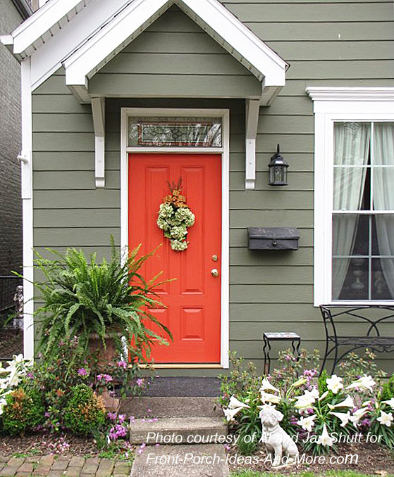 small front porch with gable roof and red door