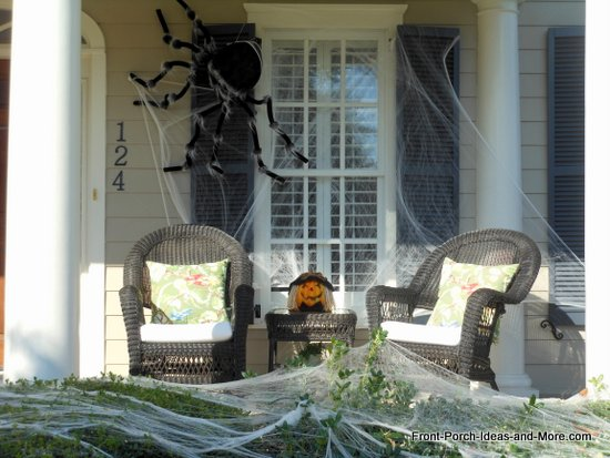 scary halloween decorations - furry spiders and spider webs on the porch