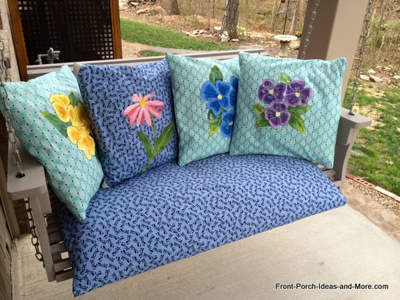 The four spring pillows make for a nostalgic setting on our porch swing