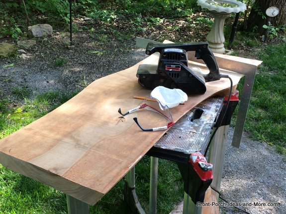 square on garden bench seat shows bowed wood