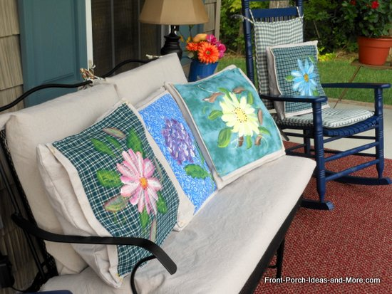 summer on our porch with bright flower pillow toppers