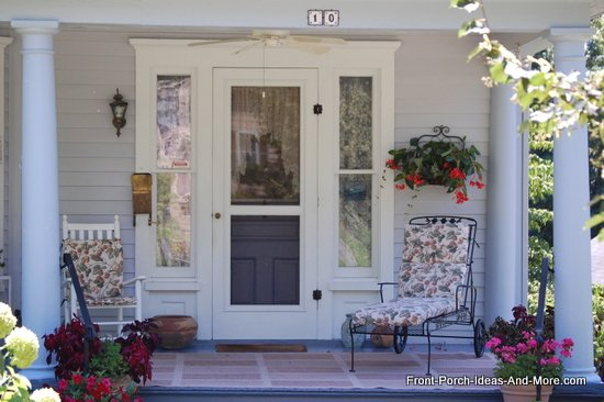 summer front porch with neat furniture