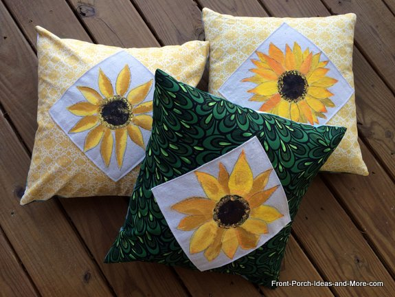 Three sunflower pillows we made for our front porch for autumn decorating