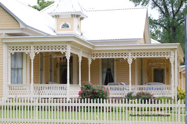 gorgeous yellow home with idyllic wrap around front porch