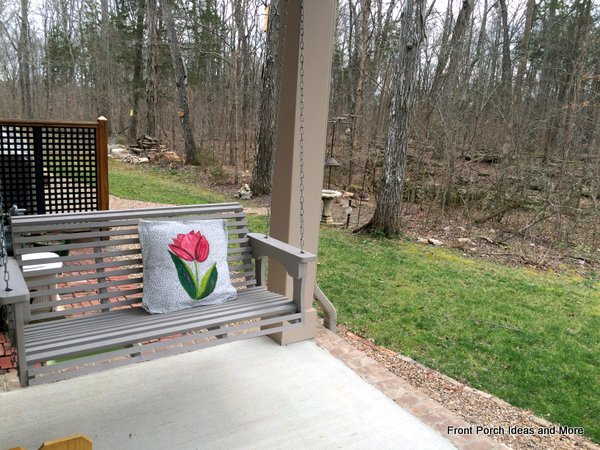 Spring decorating idea: add a tulip pillow to the porch swing