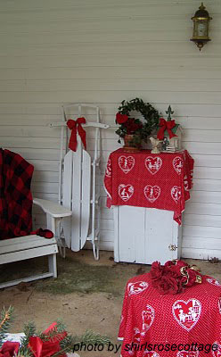 Valentine front porch complete with decorated winter sled
