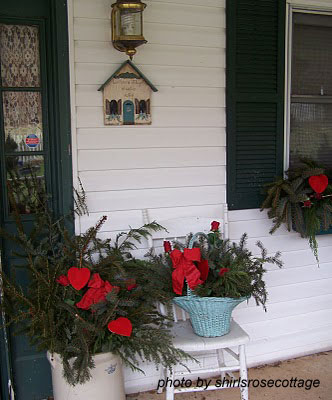 front porch with outdoor light and Valentine decorations