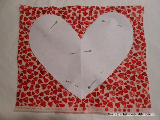 Swatch of sparkly red valentine fabric and paper heart template