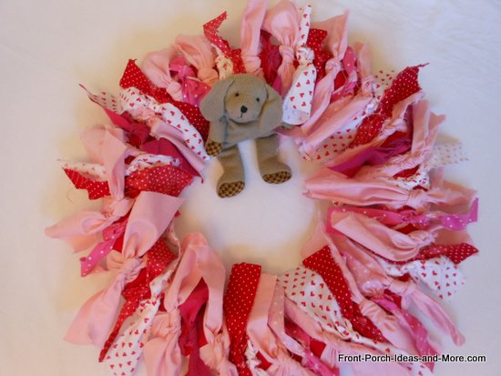 Pink and red valentine wreath craft all done with little dog in the middle