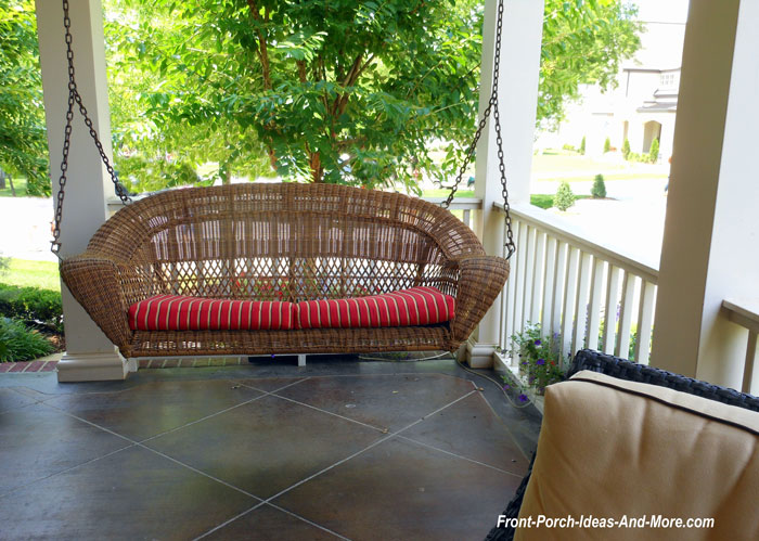 elegant wicker porch swing on front porch