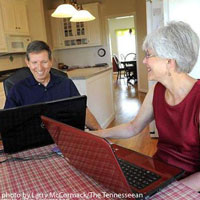 Dave and Mary at kitchen table - in Tennessean article