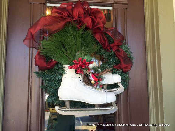 Beautiful wreath on the front door with vintage skates