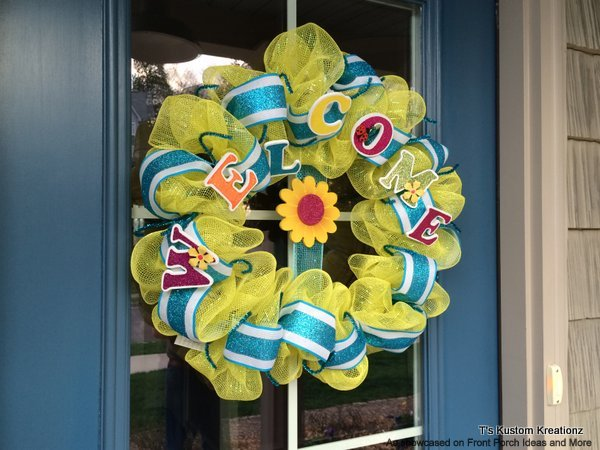 Decorative front door wreath in lovely yellow spells welcome